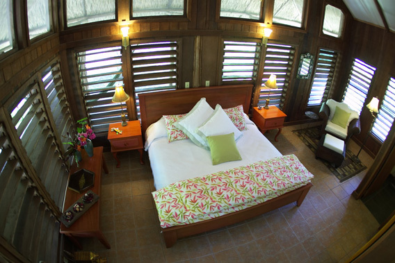 chan chich lodge, belize, thatched roof cabanas in the heart   of the Mayan empire in Belize and the 