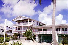 The San Pedro Holiday Hotel, is an attractive, colonial-style, three storey hotel located right on the beach in the heart of San Pedro, Ambergris Caye, Belize, overlooking the Caribbean and the Belize Barrier Reef which is only half a mile offshore.
