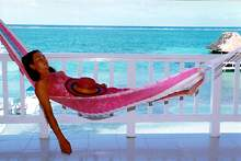 Your vacation escape to the tropics! Located right on the beach, in the heart of San Pedro on the beautiful island of Ambergris Caye, Belize.  All of San Pedro's small town charms await you at the doorstep. You'll be cooled by the trade winds off a coral blue Caribbean Sea while enjoying the peace of your own private balcony overlooking the longest coral reef in the western hemisphere.