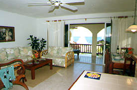 sitting room at the palms oceanfront resort, apartments andd condos, belize, Belize travel, Belize tourism, Belize hotels, Ambergris Caye hotels,hotel,palms,ambergris caye,lodging,condominium,condominiums,hotel,the palms,the palms,the palms,the palms,san pedro hotel,palms,palms,palms,lodging,condominiums,condos, ambergriscaye,ambergris caye,caribbean,belize,hotel,palms,ambergris caye
