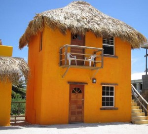 Caye Caulker Belize - Seaside Cabanas - Picturesque thatch-roofed, cabanas 50 feet from the Caribbean in beautiful Caye Caulker, Belize. Cabanas come with private bath, personal refrigerator, coffee maker, phone and cable TV.
