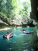 cave tubing on a day tour at Jaguar Paw jungle lodge in the Belize jungle